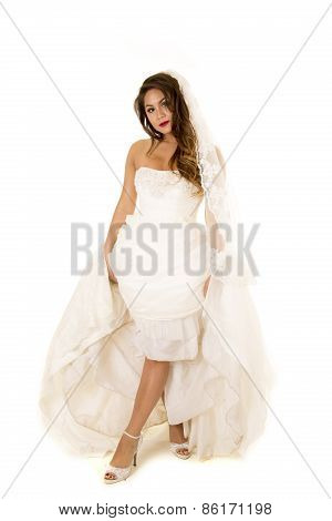 Woman In A Wedding Dress Showing Her Legs