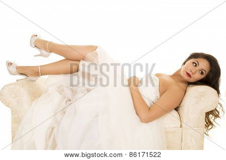 Woman Laying In Wedding Dress Legs Out Look Back