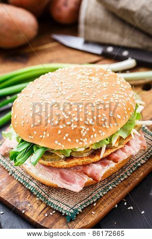 Burger with potato pancake and bacon