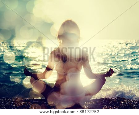 Woman Practicing Yoga by the Sea