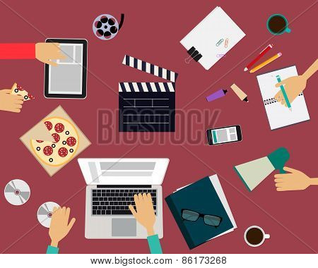 The team is working in the movie studios at the table. Vector illustration