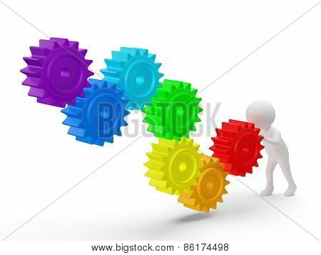 3d small person rolls a large rainbow colors gears . 3d image. Isolated white background.