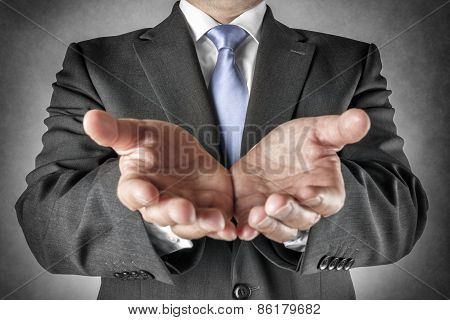 Businessman Holds Out Hands