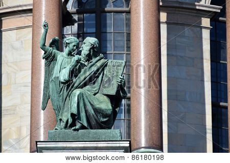 ST. PETERSBURG, RUSSIA - MARCH 5, 2015: Sculpture of apostle Matthew on the St. Isaac's cathedral. Sculptures of apostles for the cathedral created by Giovanni Vitali