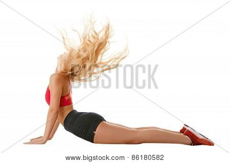 Side view of sporty girl training muscles of back