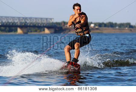 Happy Handsome Man Wakesurfing
