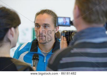 DNEPROPETROVSK, UKRAINE - APRIL 4, 2013: Alexander Dolgopolov, Ukraine talks with press before Davis Cup match Ukraine vs Sweden. Ukraine won the match 3-2