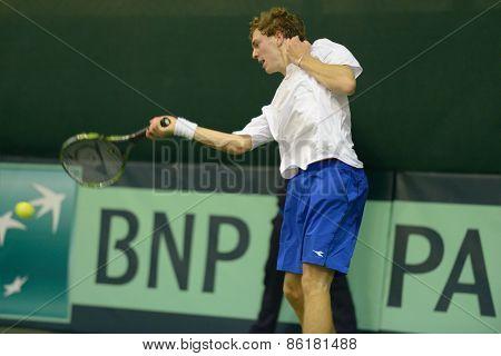 DNEPROPETROVSK, UKRAINE - APRIL 5, 2013: Isak Arvidsson, Sweden in the Davis Cup match Ukraine vs Sweden. Ukraine won the match 3-2