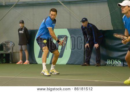 DNEPROPETROVSK, UKRAINE - APRIL 6, 2013: Sergey Stakhovsky (left) and Denis Molchanov, Ukraine in the Davis Cup match Ukraine vs Sweden