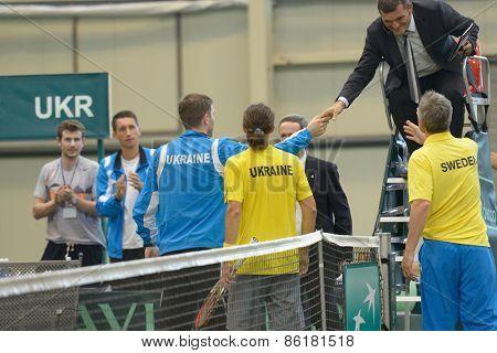 DNEPROPETROVSK, UKRAINE - APRIL 5, 2013: Alexander Dolgopolov, Ukraine (in center) after the Davis Cup match Ukraine vs Sweden. Ukraine won the match 3-2