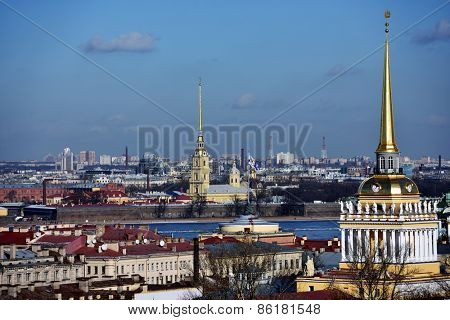 ST. PETERSBURG, RUSSIA - MARCH 5, 2015: Cityscape viewed from the St. Isaac's Cathedral with the spire of Admiralty and the spire of the Peter and Paul Cathedral. It is two most famous spires of city