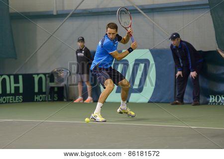 DNEPROPETROVSK, UKRAINE - APRIL 6, 2013: Sergey Stakhovsky, Ukraine in the Davis Cup match Ukraine vs Sweden. Ukraine won the match 3-2
