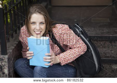 Gorgeus blond woman with blue book