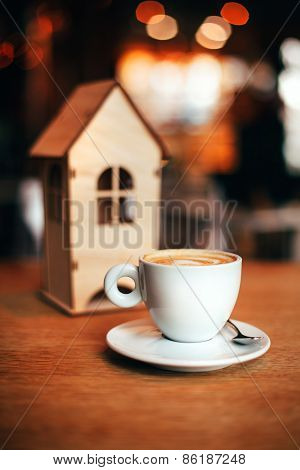 little house with coffee cup