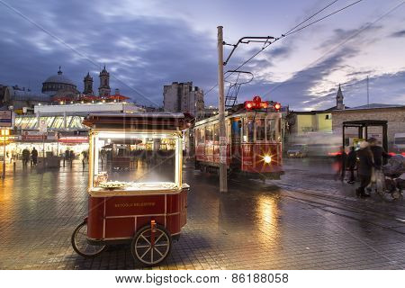 Pedler and historical tram at Taksim square