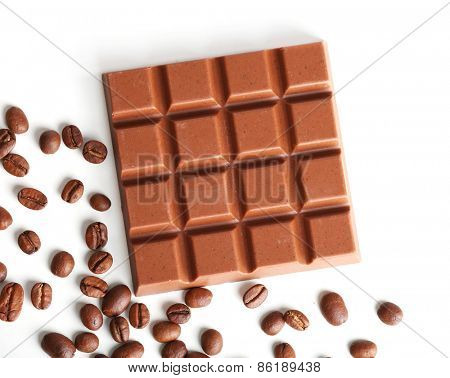 Milk chocolate bar with coffee beans isolated on white
