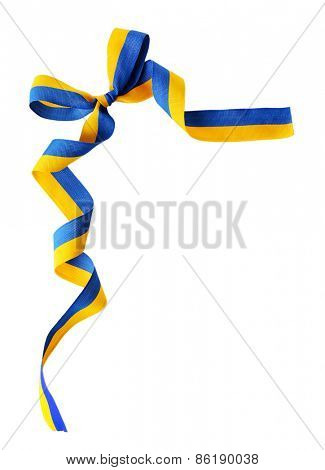 Colorful blue-yellow fabric ribbon with bow isolated on white