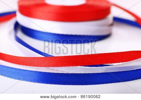 Colorful ribbons on white background