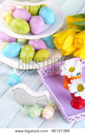 Easter decoration, eggs and tulips on table close-up