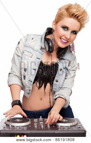 DJ girl with headphones at dj mixer playing isolated on white