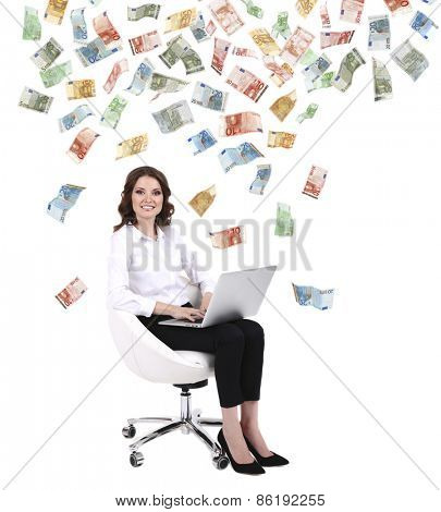 Successful businesswoman with pile of money