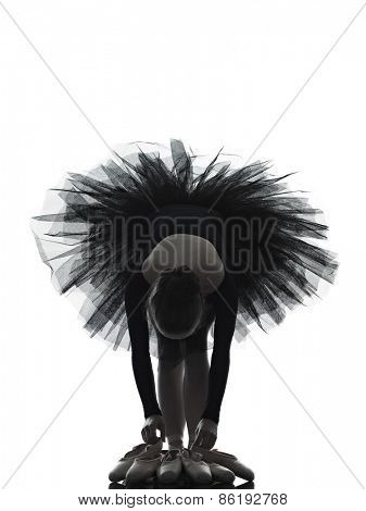 one  young woman ballerina ballet dancer dancing with tutu in silhouette studio on white background
