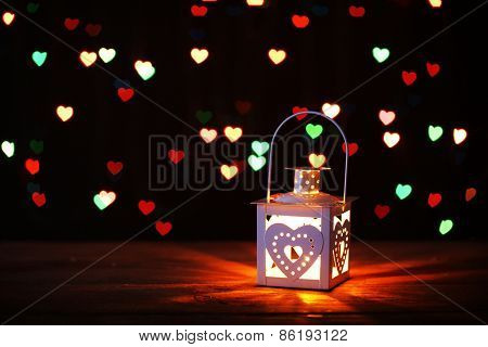 Romantic lantern on lights background, love concept