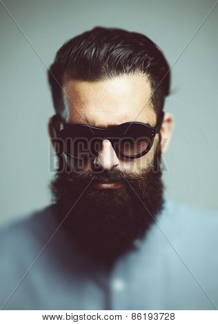 Portrait Of Brutal Hipster Wearing Sunglasses