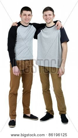 Two handsome young men isolated on white