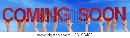 People Hands Holding Red Straight Word Coming Soon Blue Sky