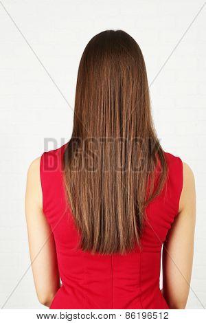 Long shine female hair on light background