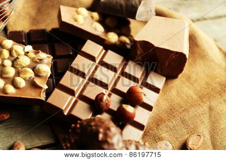 Still life with set of chocolate with nuts on burlap cloth, closeup