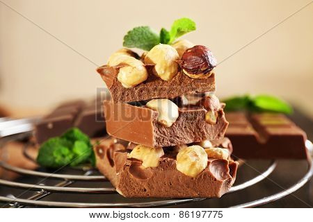 Stack of chocolate with nuts on light background