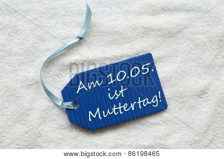 Muttertag Means Mothers Day On Blue Label Sand Background