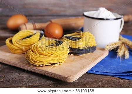 Still life of preparing pasta on rustic wooden background