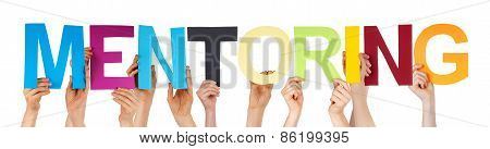 Many People Hands Holding Colorful Straight Word Mentoring