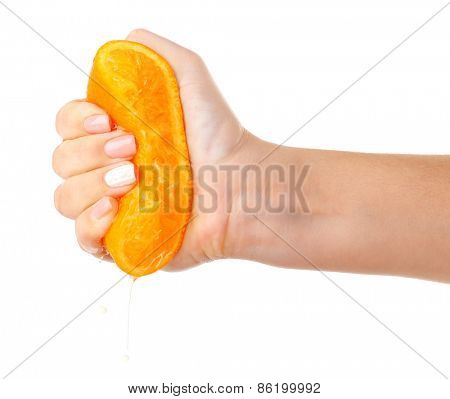 Female hand squeezing orange isolated on white