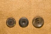 picture of hasp  - A lot of old buttons scattered on the old cloth
