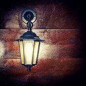 stock photo of luminaria  - The Lamp lantern on a wooden background - JPG