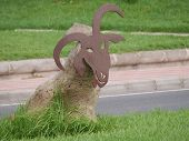 image of stone sculpture  - Sculptures of goats made of  stones and a mask of corten steel in the Streets of Puerte del Rosario on Fuerteventura - JPG