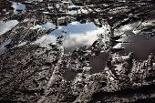 pic of mud  - Mud and puddles on the dirt road - JPG