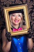 picture of cabaret  - beautiful cabaret woman posing with golden frame against retro wallpapers - JPG