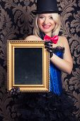 foto of cabaret  - beautiful cabaret woman posing with golden frame against retro wallpapers - JPG