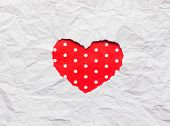 stock photo of cut torn paper  - White torn paper in heart shape symbol over red background - JPG