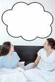 stock photo of bubble sheet  - Handsome man and pretty surprised woman in bedroom looking up at thinking speech bubble comic cloud or empty copyspace - JPG