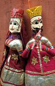 stock photo of rajasthani  - Beautiful Rajasthani puppet couple in traditional Indian costume in portrait orientation - JPG