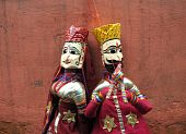 stock photo of rajasthani  - Beautiful Rajasthani doll couple in traditional Indian costume - JPG