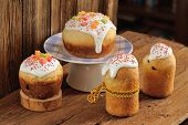 image of easter candy  - Kulich Russian easter sweet breads decorated with icing and candied fruits on wooden background horizontal - JPG