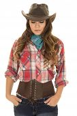 picture of cowgirls  - a cowgirl in her western clothing with her hands in her pocket looking down - JPG