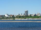 stock photo of pontoon boat  - View of the city beach of the Volga River in the city of Volgograd - JPG